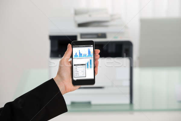 Businesswoman Hand Giving Print Command On Smart Phone Stock photo © AndreyPopov