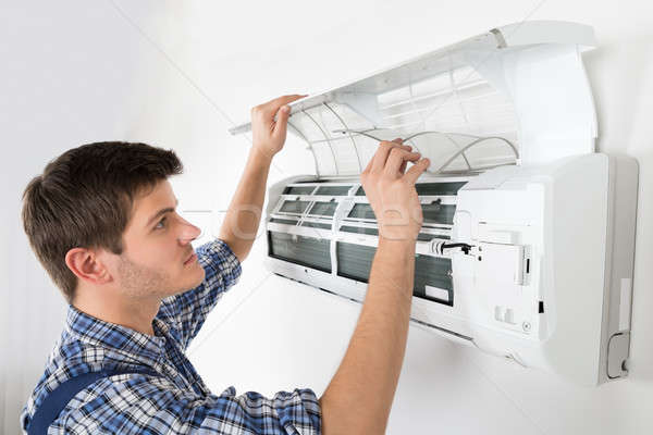 Male Technician Cleaning Air Conditioning System Stock photo © AndreyPopov
