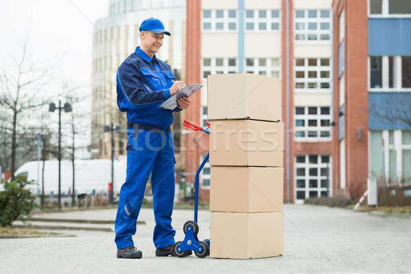 Portrait Of Delivery Man With Parcels And Clipboard Stock photo © AndreyPopov