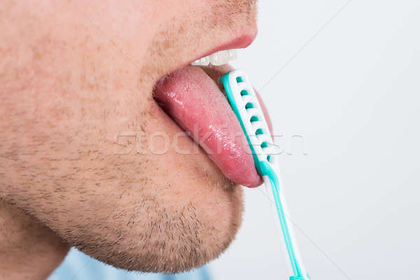 Man Cleaning Her Tongue Stock photo © AndreyPopov