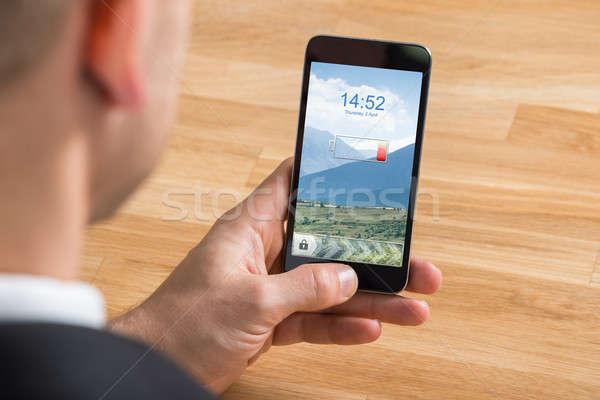 бизнесмен мобильного телефона низкий батареи Сток-фото © AndreyPopov