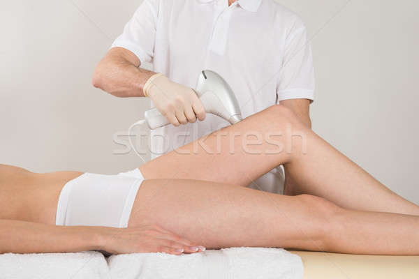 Woman Receiving Epilation Treatment On Legs At Spa Stock photo © AndreyPopov