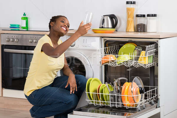 Happy African Woman Looking At Clean Glass Stock photo © AndreyPopov