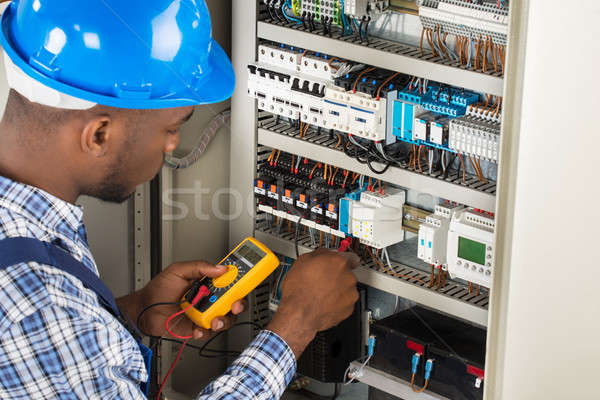 Electrician Checking Fuse Box With Multimeter Stock photo © AndreyPopov
