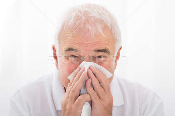 Man Infected With Cold Blowing His Nose Stock photo © AndreyPopov