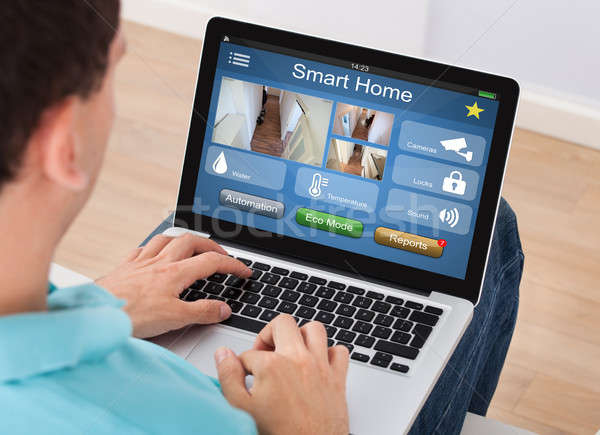 Man Using Smart Home System On Mobilephone Stock photo © AndreyPopov