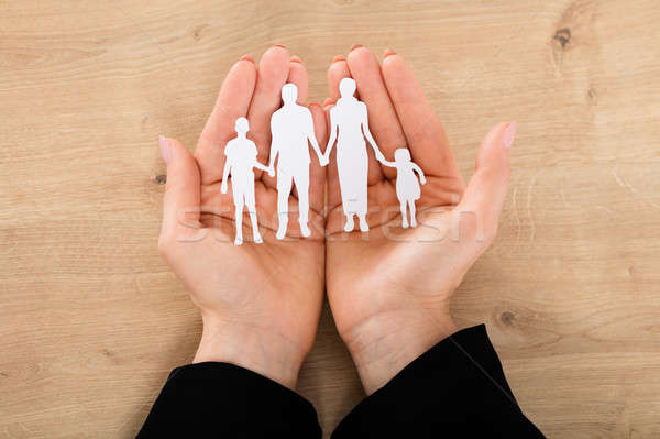 Woman Hand Holding Family Papercut Stock photo © AndreyPopov