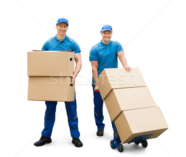 Two Delivery Men With Cardboard Boxes Stock photo © AndreyPopov