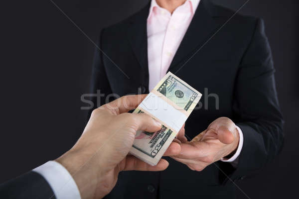 Businessman Receiving A Bank Note Stock photo © AndreyPopov