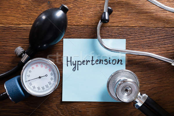 Medical Concept Of Hypertension On Wooden Desk Stock photo © AndreyPopov