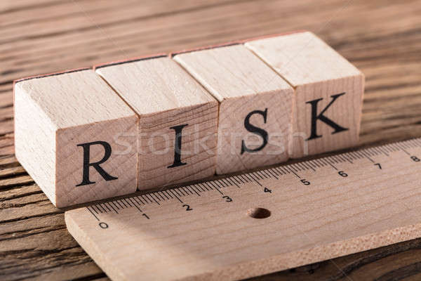 Risk Concept With Wooden Ruler Stock photo © AndreyPopov
