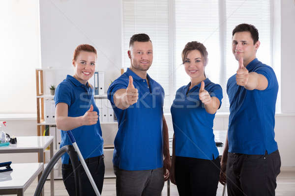 Janitors Showing Thumb Up Sign In The Office Stock photo © AndreyPopov