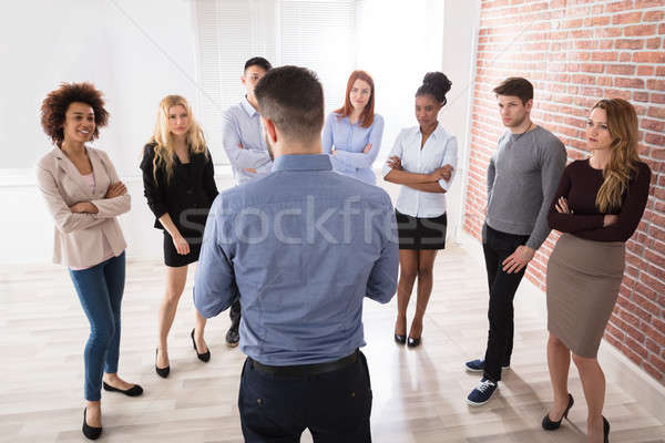 Gerente conversa negócio colegas escritório Foto stock © AndreyPopov