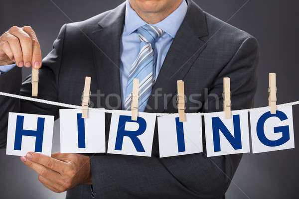 Businessman Pinning HIRING Cards On Clothesline Stock photo © AndreyPopov