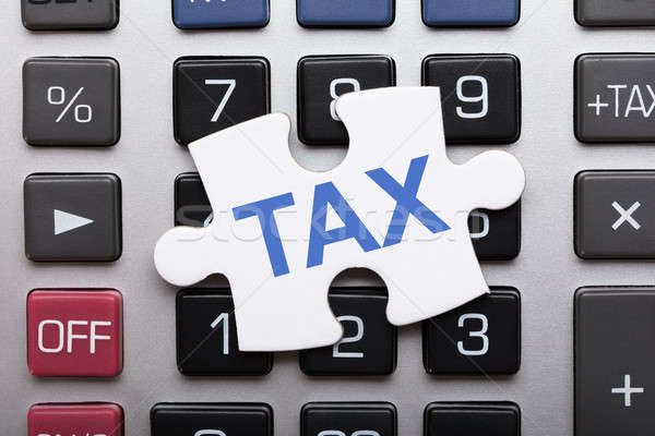Jigsaw Puzzle Piece With Tax Text On Calculator Stock photo © AndreyPopov