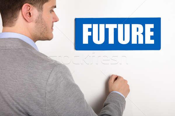 Businessman Knocking Door With Future Text Stock photo © AndreyPopov