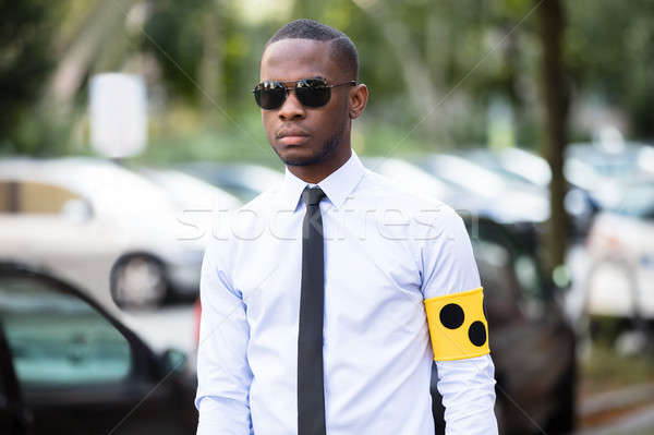 Blind Man Wearing Yellow Arm Band And Sunglasses Stock photo © AndreyPopov