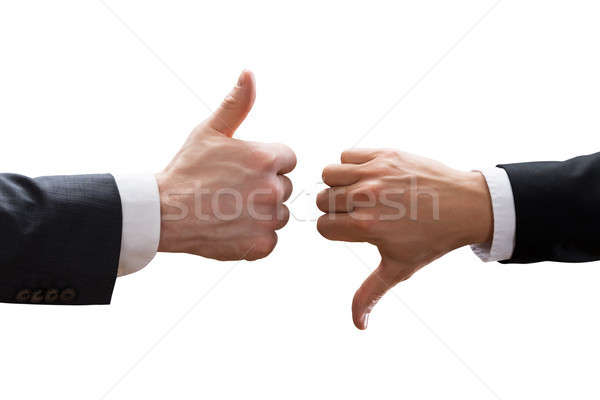 Two Businesspeople Hands Showing Thumb Up And Thumb Down Sign Stock photo © AndreyPopov