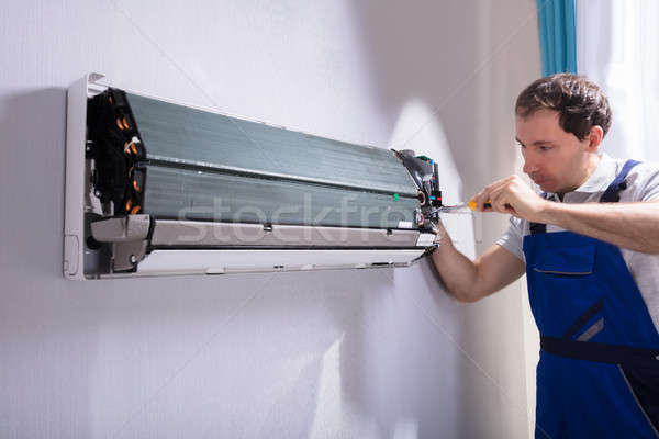 Technician Repairing Air Conditioner Stock photo © AndreyPopov