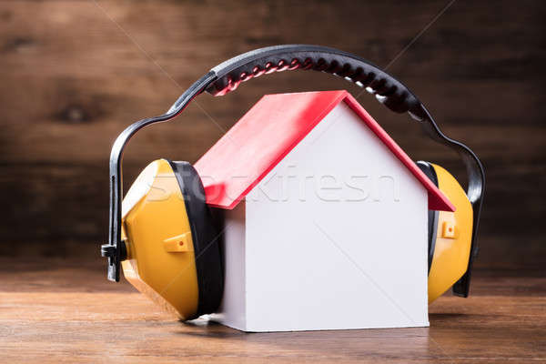 Working Protective Headphone On The House Model Stock photo © AndreyPopov