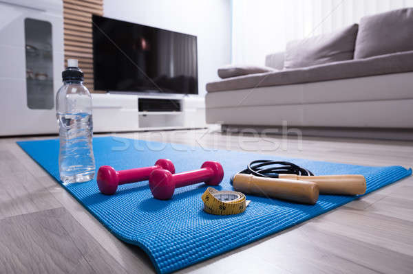 Skipping Rope And Pink Dumbbells On Exercise Mat Stock photo © AndreyPopov