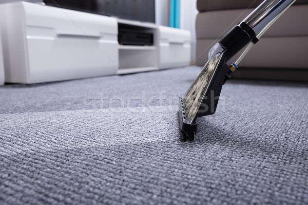Aspirapolvere tappeto primo piano grigio home interni Foto d'archivio © AndreyPopov