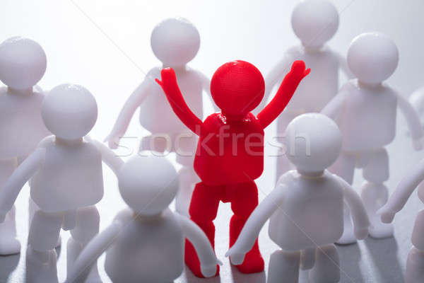 Red Human Figure Surrounded By Team Stock photo © AndreyPopov