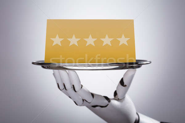 Robot Holding Plate With Star Rating Stock photo © AndreyPopov