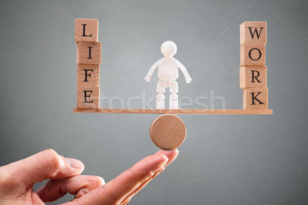 Person's Hand With Work And Life Wooden Blocks On Seesaw Stock photo © AndreyPopov