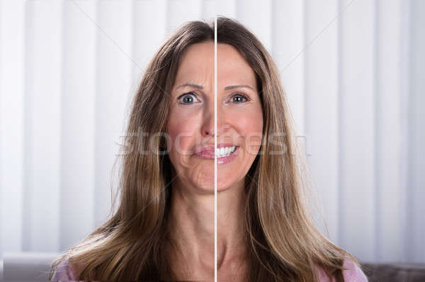Woman's Split Face With Happy And Sad Emotion Stock photo © AndreyPopov