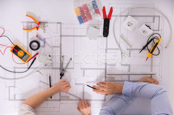 Elevated View Of Architect's Hand On Blueprint Stock photo © AndreyPopov