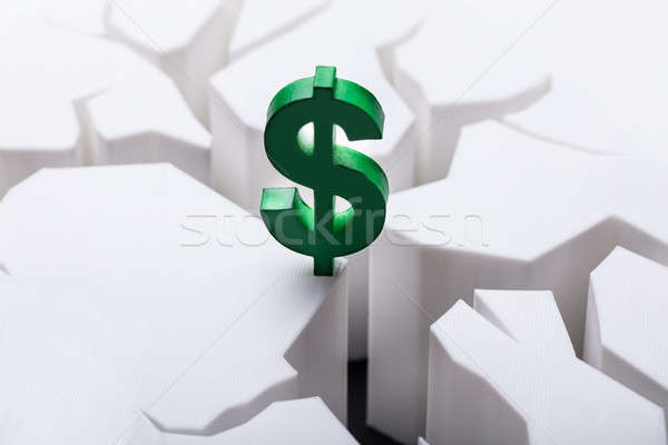 Dollar Currency Sign On Damaged White Surface Stock photo © AndreyPopov