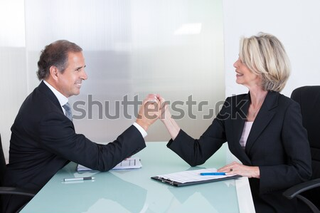 Mature Businessman And Businesswoman Fighting Stock photo © AndreyPopov