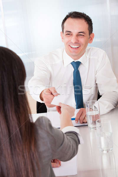 Two Business People Exchanging Card Stock photo © AndreyPopov