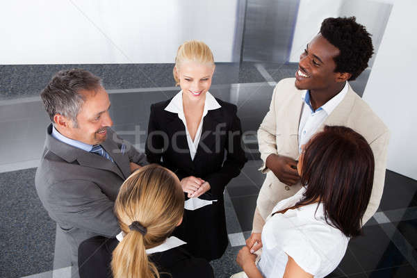 Mature Businessman With His Colleagues Stock photo © AndreyPopov