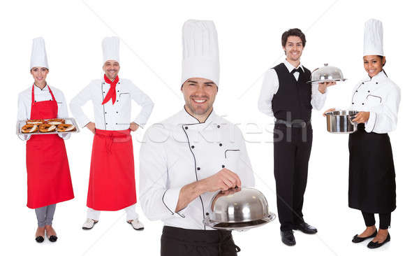 Group of chef and waiters Stock photo © AndreyPopov
