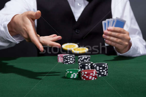 Poker player increasing his stakes Stock photo © AndreyPopov