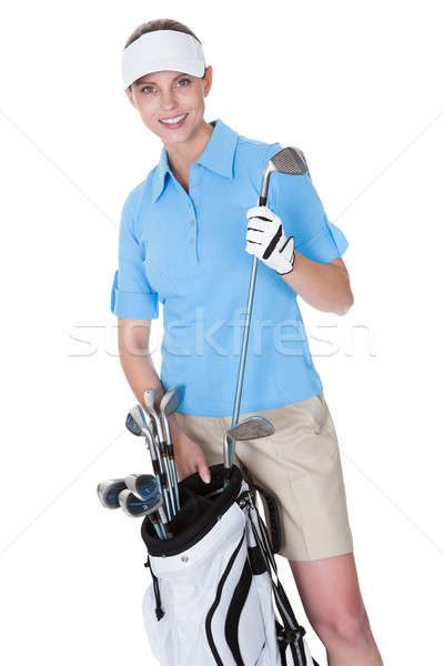 Golfer with a bag of clubs Stock photo © AndreyPopov