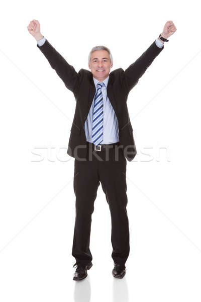 Stock photo: Portrait Of Excited Mature Businessman