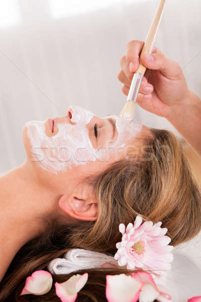 Beautician applying a face mask Stock photo © AndreyPopov