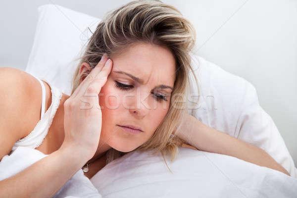 Portrait of woman with headache Stock photo © AndreyPopov