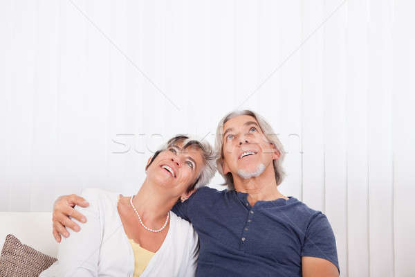 Loving senior couple daydreaming Stock photo © AndreyPopov