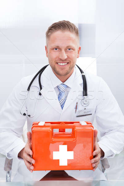 Doctor or paramedic in a white lab coat with a stethoscope Stock photo © AndreyPopov