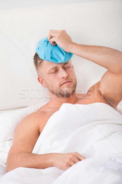 Człowiek kac ciężki noc imprezy Zdjęcia stock © AndreyPopov