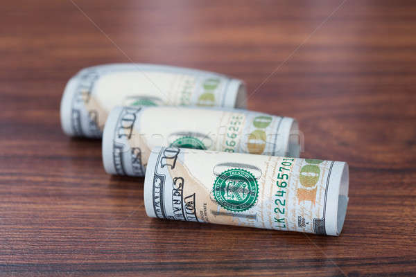 Rolled American Banknotes On Table Stock photo © AndreyPopov