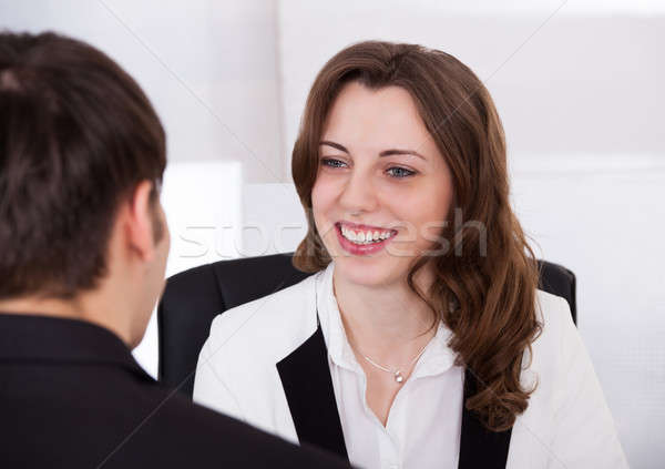 Businesswoman Looking At Candidate During Interview Stock photo © AndreyPopov