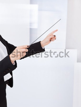 Hands of a music conductor with a baton Stock photo © AndreyPopov