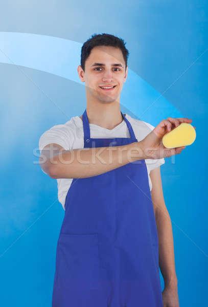 Férfi szolgáló takarítás üveg szivacs portré Stock fotó © AndreyPopov