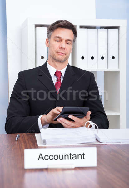 Male Accountant Working In Office Stock photo © AndreyPopov