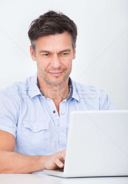 Man Using Laptop Stock photo © AndreyPopov